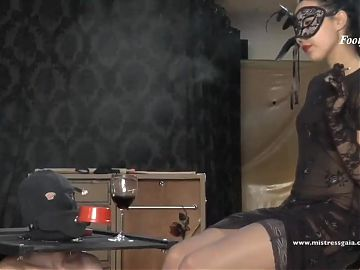 Footjob mistress teases her human table – preview